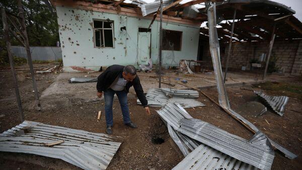 Разрушения в городе Агдам, Азербайджан после обстрела со стороны Нагорного Карабаха - Sputnik Грузия