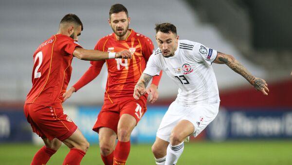 Матч между сборными Грузии и Македонии по футболу при пустых трибунах на стадионе Динамо Арена - Sputnik Грузия