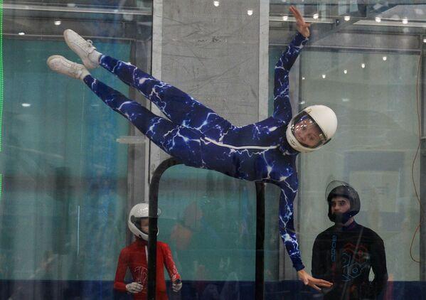 Выступление участницы соревнований на чемпионате России по аэродинамическим дисциплинам парашютного спорта Goodsky-2019 в Российском университете спецназа - Sputnik Грузия