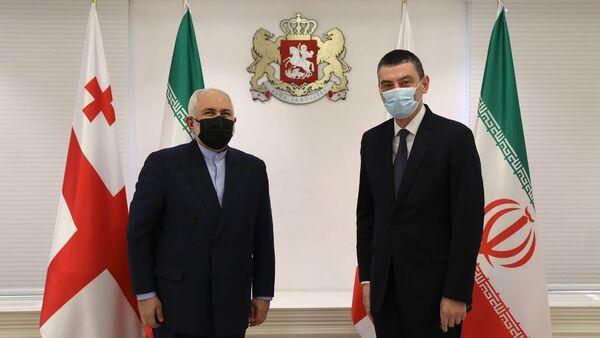 საქართველოს პრემიერ-მინისტრი გიორგი გახარია და ირანის ისლამური რესპუბლიკის საგარეო საქმეთა მინისტრი მუჰამედ ჯავად ზარიფი - Sputnik საქართველო