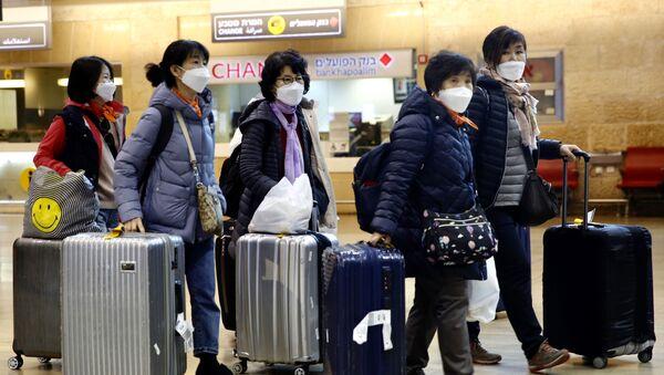 Пандемия коронавируса - туристы из Южной Кореи в масках - Sputnik Грузия