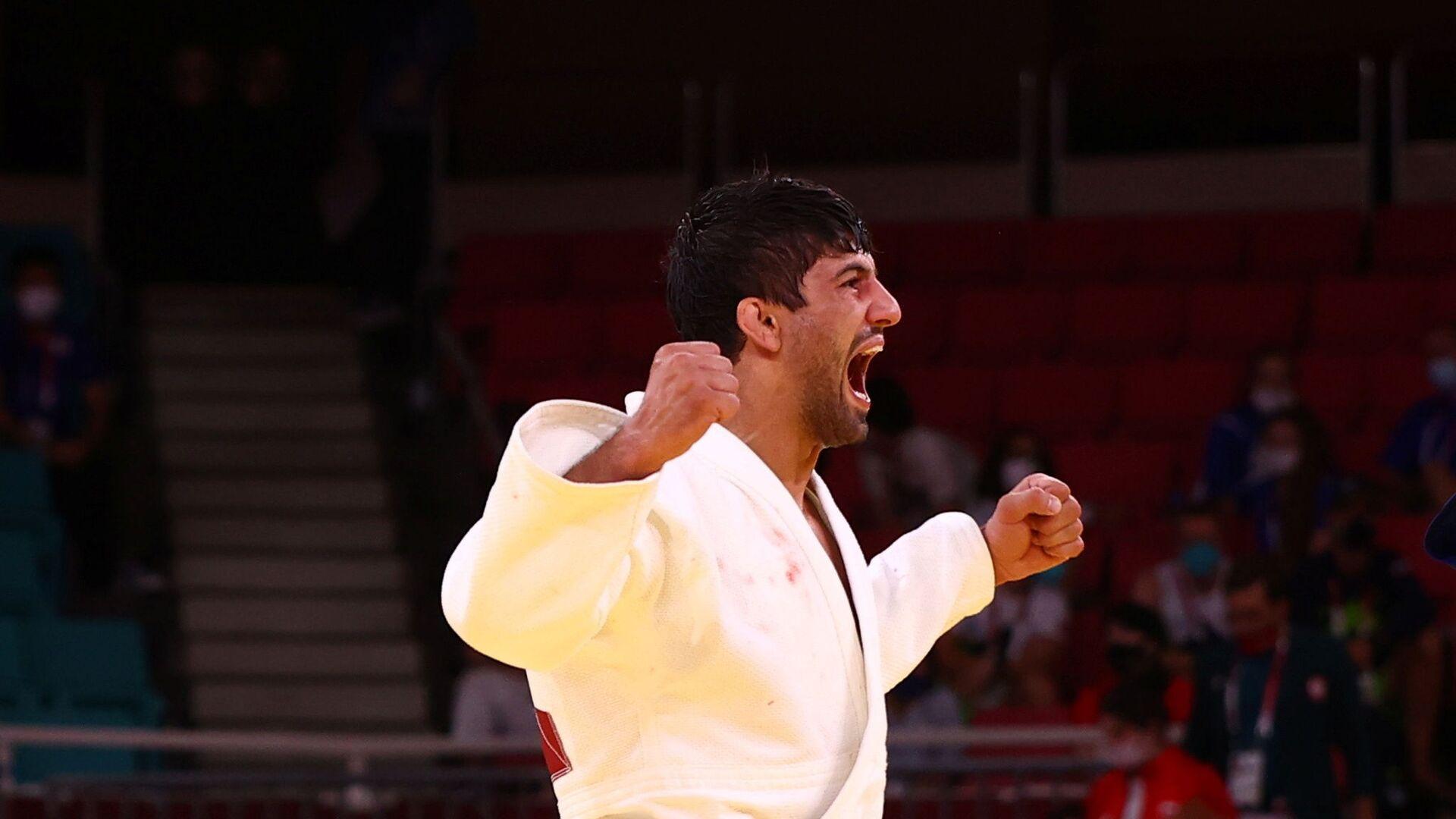 Лаша Шавдатуашвили на Олимпиаде в Токио радуется победе - Sputnik საქართველო, 1920, 24.08.2021