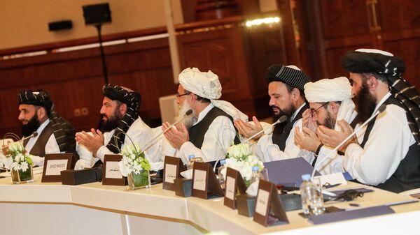 Члены движения Талибан присутствующие на втором дне переговоров внутриафганского диалога - Sputnik Грузия