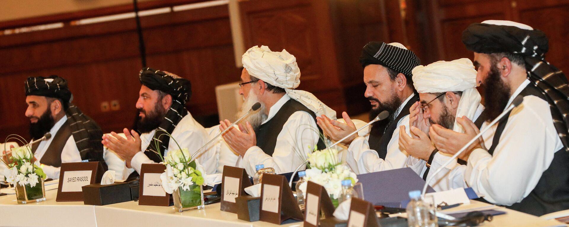 Члены движения Талибан присутствующие на втором дне переговоров внутриафганского диалога - Sputnik Грузия, 1920, 21.09.2021