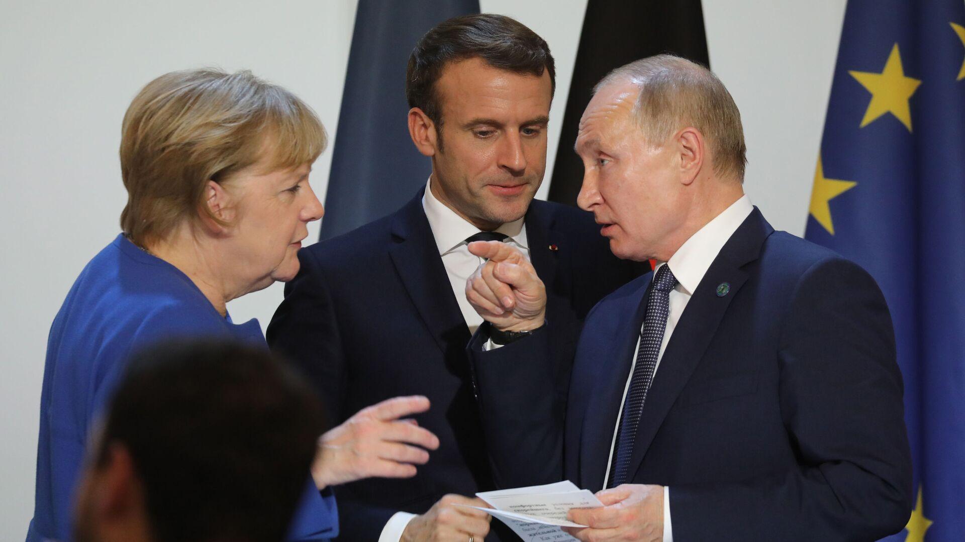 Канцлер Германии Ангела Меркель, президент Франции Эммануэль Макрон и президент России Владимир Путин - Sputnik Грузия, 1920, 12.10.2021