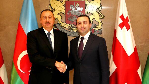 Премьер Грузии Ираклий Гарибашвили и президент Азербайджана Ильхам Алиев - Sputnik Грузия