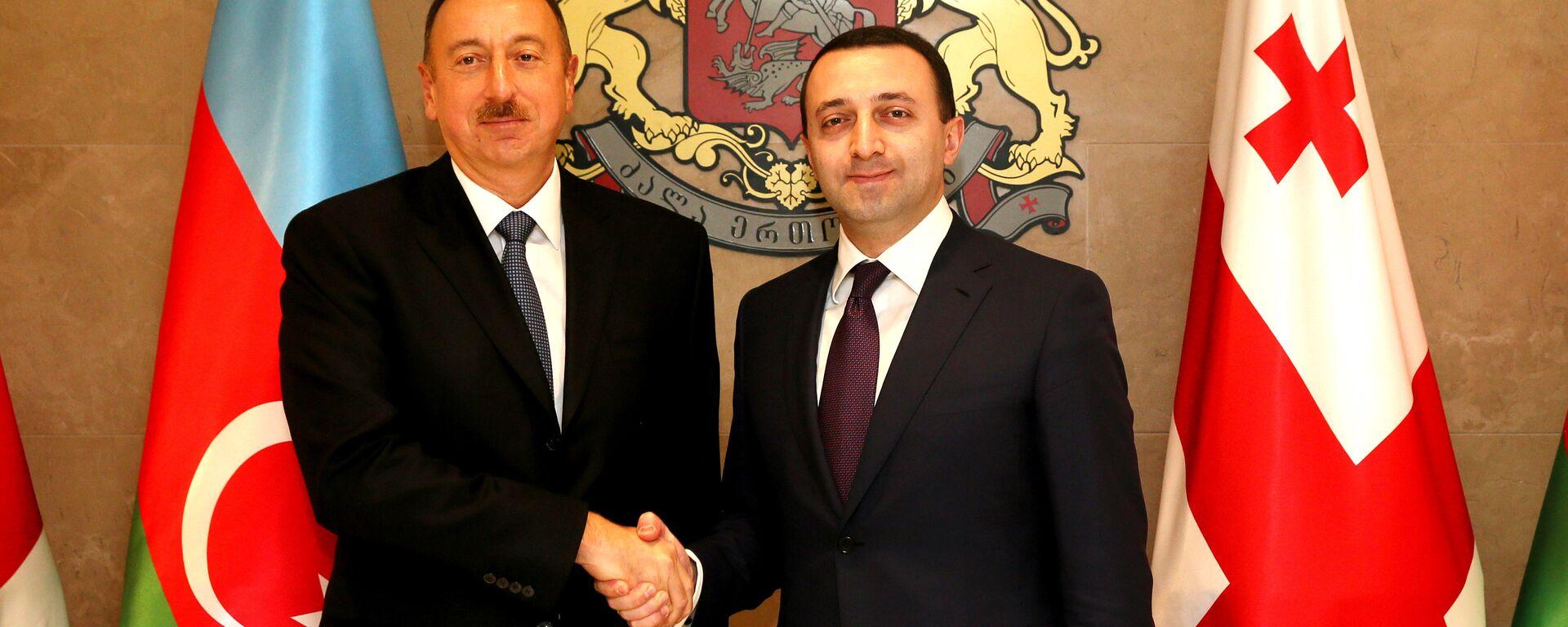 Премьер Грузии Ираклий Гарибашвили и президент Азербайджана Ильхам Алиев - Sputnik Грузия, 1920, 28.05.2021
