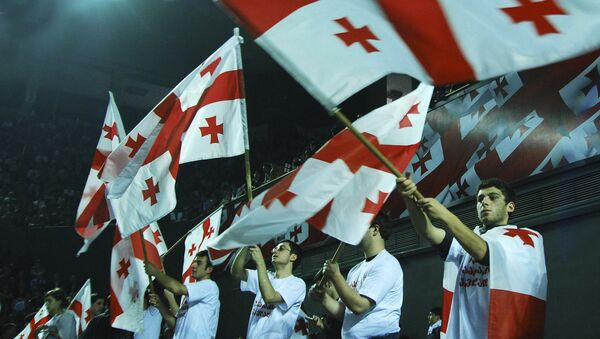 Флаги Грузии в руках участников съезда ЕНД, архивное фото - Sputnik Грузия