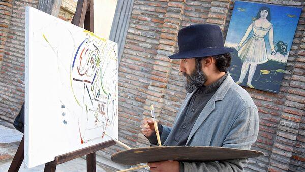 Артист, изображающий художника Пиросмани, на проспекте Агмашенебели - Sputnik Грузия