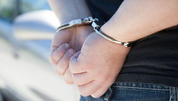Арестованный в наручниках - Sputnik Грузия