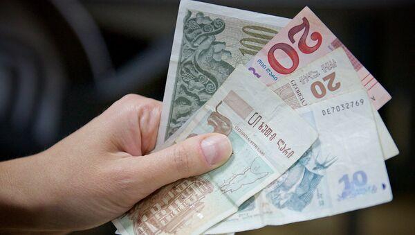 Купюры грузинской валюты - лари различного номинала - Sputnik Грузия