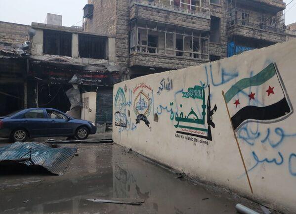 Так выглядит один из кварталов в восточном Алеппо после успешного наступления сирийской армии, взявшей под контроль город - Sputnik Грузия