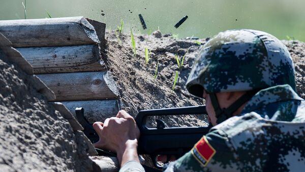 Военнослужащий армии Китая на огневом рубеже на международном конкурсе Рембат - Sputnik Грузия