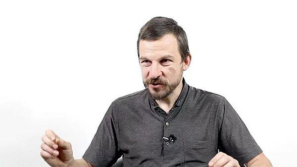 Доцент Международного института экономики и финансов Алексей Белянин - Sputnik Грузия