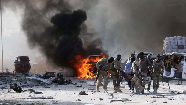 На месте взрыва в районе Ходан в городе  Могадишо в Сомали - Sputnik Грузия