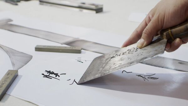 Китайский каллиграф рисует иероглифы поварскими ножами - Sputnik Грузия