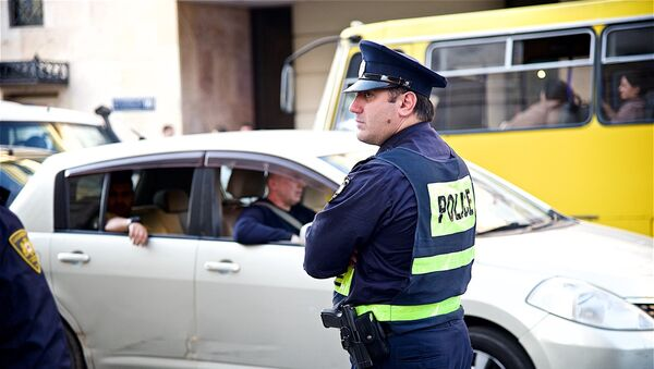 Сотрудник патрульной полиции - Sputnik Грузия