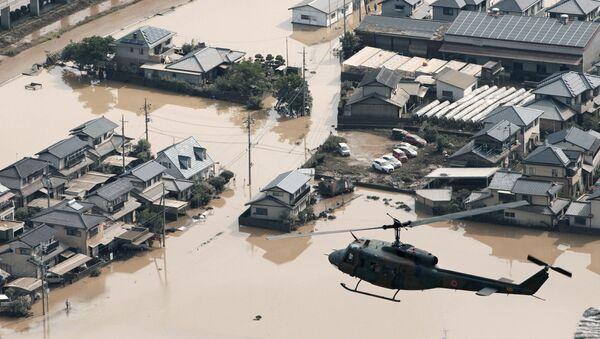 Наводнение в Японии - населенный пункт Маби под водой после ливневых дождей в провинции Курашики, Окияма - Sputnik Грузия