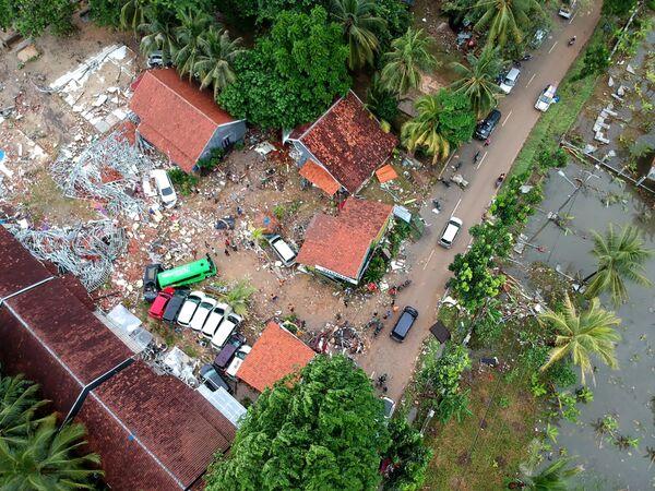 В результате цунами сотни домов и зданий оказались разрушены    - Sputnik Грузия