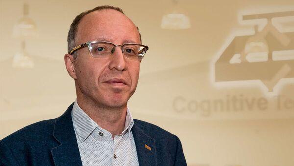Руководитель департамента разработки беспилотных транспортных средств Cognitive Technologies Юрий Минкин - Sputnik Грузия