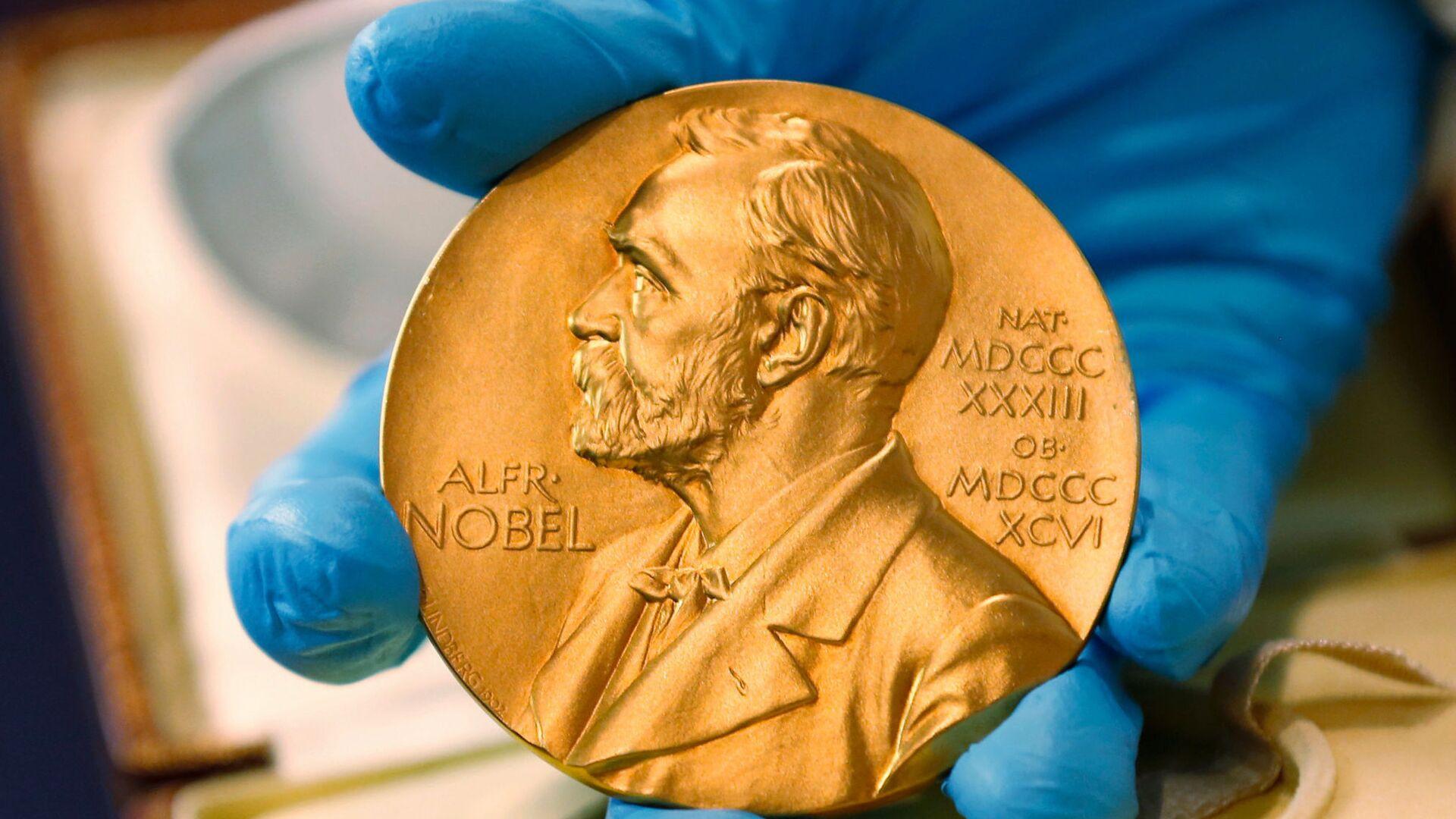 Нобелевская медаль вручается с Нобелевской премией - Sputnik Грузия, 1920, 04.10.2021
