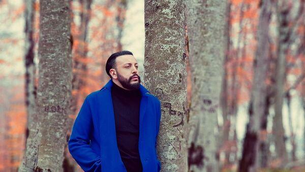 Фотокадр из клипа на песню Холодный ноябрь Анри Джохадзе - Sputnik Грузия