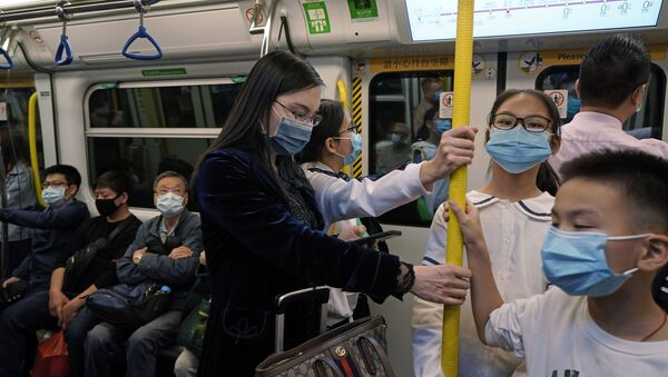 Жители Китая в масках в разгар эпидемии коронавируса - Sputnik Грузия