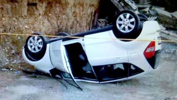 Перевернувшийся в результате ДТП автомобиль - Sputnik Грузия